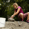 Shelby Woodward, 9, of Corydon, searches for minerals and fossils in a collecting pile during Earth Discovery Day at the Falls of the Ohio State Park in Clarksville on Saturday afternoon. The park provided various rock piles quarried from other areas to give visitors the opportunity to make geological discoveries without illegally disturbing the park. Staff photo by Christopher Fryer