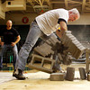 Craig Pumphrey demolishes a stack of nine concrete blocks during a strength demonstration at the Floyd Central High School Student Renaissance Academic Pep Rally on Friday afternoon in the school's gymnasium. Around 1,000 students were at the super hero themed rally to recognize students for their academic achievements. Staff photo by Christopher Fryer