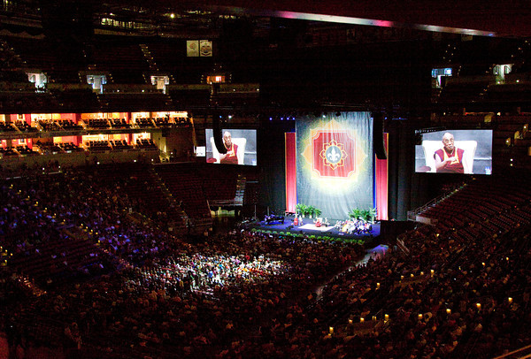 The Dalai Lama addresses questions from the audience during a public talk that focused on compassion and its importance in today's world at the KFC Yum! Center in Louisville on Sunday afternoon. Staff photo by Christopher Fryer