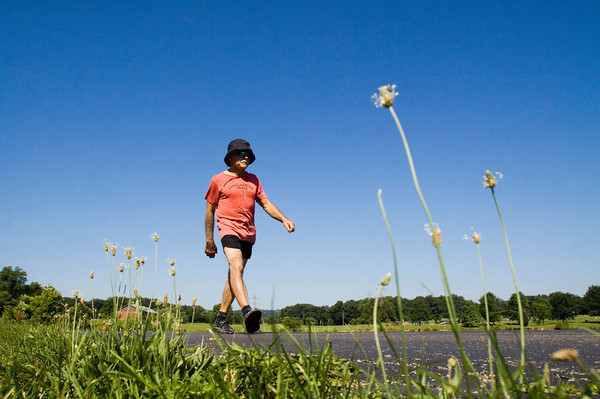 """Ted Derloshon, of New Albany, makes his way around the pedway at Sam Peden Community Park in New Albany on Friday morning. Derloshon walked 65 loops and """"one to grow on"""" for a total of 66 miles in honor of his 65th birthday, and to promote health. Staff photo by Christopher Fryer"""