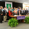 Indiana Gov. Mike Pence signs House Enrolled Act 1312 next to State Rep. Ed Clere during a ceremony with students and administrators from Ivy Tech Community College Southern Indiana, Indiana University Southeast and Purdue University College of Technology at New Albany in the Community Room at Ivy Tech on Wednesday afternoon. The new law was officially signed earlier this month. Pence also ceremonially signed House Bill 1005 at the event. Staff photo by Christopher Fryer
