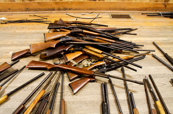 Rifles and shotguns sit in a pile on the floor after they were purchased during a buyback program at the Ekin Avenue Recreation Center in New Albany on Friday afternoon. The buyback lasted less than two hours and 249 firearms were purchased before the $50,000 ceiling for the program was reached. Staff photo by Christopher Fryer