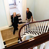 Vicki Reed and her husband the Rev. Don Reed, both of New Albany, make their way down a staircase while touring the Pepin Mansion, located at 1003 E. Main St., in New Albany on Thursday afternoon. Owner Ron Smith held an official grand opening for the restored home on Thursday, which he is operating as a retreat center, rehearsal hall and bed and breakfast. Staff photo by Christopher Fryer