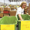 Volunteer Amber Miller itemizes food items at the Disaster Response Multi-Agency Warehouse. The warehouse delivers needed items to 20 distribution centers in areas damaged by the March, 2 tornadoes. Staff photo by C.E. Branham