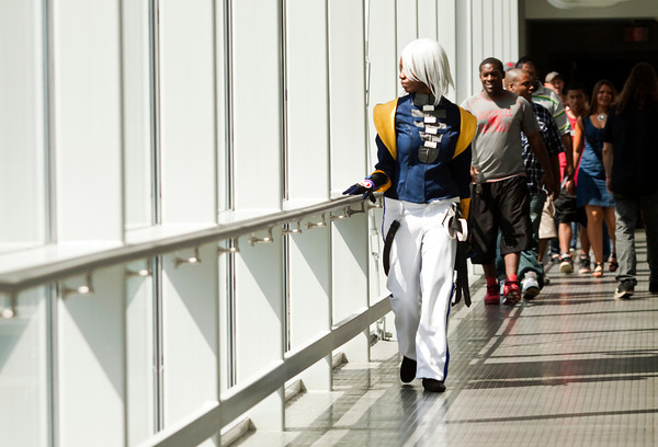 Shanice Robinson, Newport News, Va., dressed as chaos from the videogame Xenosaga walks along the pedestrian walkway that connects the Galt House and the Kentucky International Convention Center during the FandomFest Comic and Toy Expo in downtown Louisville on Saturday afternoon. Staff photo by Christopher Fryer