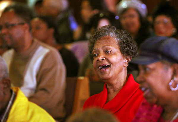 Brenda Matthews sings along with the choir during a Martin Luther King Jr. memorial service Monday at First Trinity Missionary Baptist Church in Jeffersonville. Staff photo by C.E. Branham
