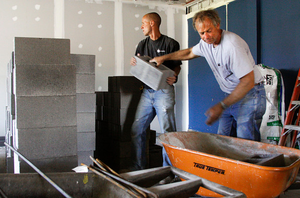 Scott Rogers, left, of Corydon, and Steve Brown, of Salem, stack cinder blocks to be used in the new elevator shaft being installed in the St. Marks United Church of Christ Education Building on Thursday morning in New Albany. Staff photo by Christopher Fryer