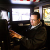 New Albany Fire Chief Matt Juliot operates the Locomotive Simulator in the Exhibit Car of the Norfolk Southern Operation Lifesaver Whistle-Stop Train during a train tour to promote highway-rail and pedestrian safety on Friday. Staff photo by Christopher Fryer