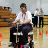 Cody Gibbs, a seventh grader, rides on a motorized cart with drunk goggles on during Our Lady of Providence's Students Against Destructive Decisions event on Wednesday. Gibbs said the exercise made him realize how dangerous drunken driving can be. Staff photo by Jerod Clapp