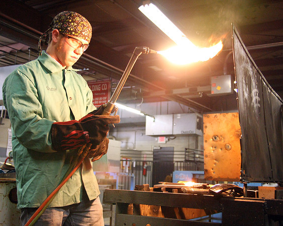 Anthony Deutsch, a senior at Breckenridge County High School, finishes up after cutting off a backing bracket from a butt joint for Prosser's sixth annual welding competition. Jeffersonville High School, Prosser and Breckenridge County High School all competed. Staff photo by Jerod Clapp