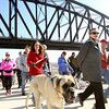Hundreds of people head up the access ramp to The Big Four pedestrian bridge Thursday morning in Louisville. The span linking Louisville and Jeffersonville is open to walkers, runners, cyclists and pets  24 hours a day.  Staff photo by C.E. Branham