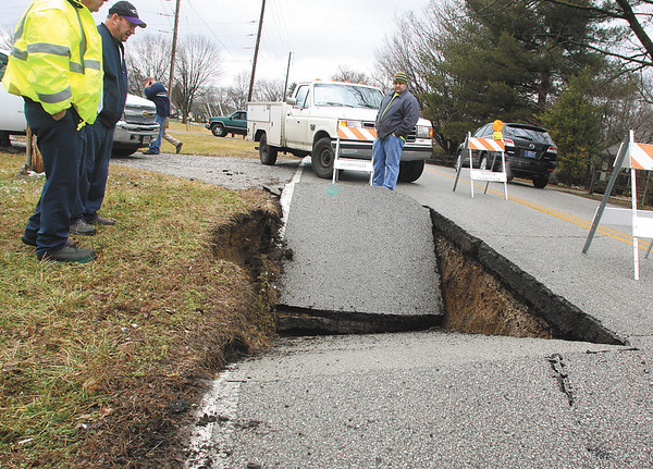 Part of the road collapsed Tuesday afternoon in the 2500 block of Lincoln Dr. in Clarksville.  Officials at the scene said the collapse was due to a sewer line.  Staff photo by C.E. Branham