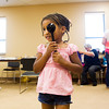 Hannah Allen, 6, of Jeffersonville, reads a chart during an eye exam at Eastside Christian Church's second annual Community Health, Education and Safety Fair in Jeffersonville on Saturday morning. Staff photo by Christopher Fryer