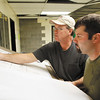 Foreman Doug Chastain, of New Albany, and plumbing foreman Matt Butler, of Seymour, go over building plans in the old Pine View Elementary School in New Albany on Thursday morning. Floyd County is currently working on a project to convert the old school to house the new youth shelter and various other county offices. Staff photo by Christopher Fryer