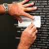 Tony Burns, of Jeffersonville, makes a rubbing of his wife Terry Lynn's sister-in-law's brother's name at the American Veterans Traveling Tribute Vietnam Wall next to the Clarksville Municipal Center along Veterans Parkway on Thursday afternoon. Staff photo by Christopher Fryer