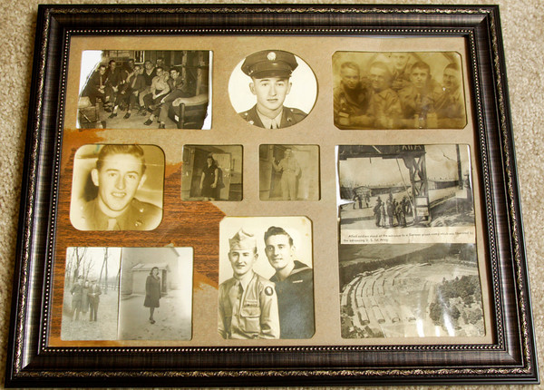 Old photographs sit in Kenneth Steward's room at Westminster Village in Clarksville on Friday morning. Steward, 87, of Jeffersonville, is a veteran and prisoner of war survivor of World War II. He was captured by the German military while serving on the front lines during the Battle of the Bulge. Staff photo by Christopher Fryer