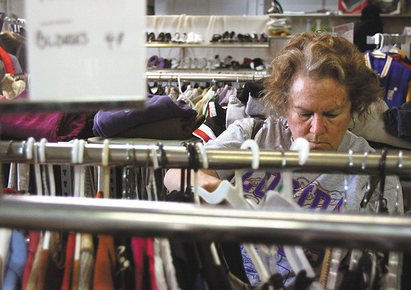 Ann Swilley looks through clothes at Lydia's Place, a thrift store located at 146 Spring St. in Jeffersonville.  The store, which will host a grand opening on Saturday, Feb. 4, is donating part of its proceeds to Jacob's Well.  Staff photo by C.E. Branham