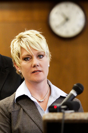 Detective Carrie East, of the New Albany Police Department, discusses information about the closure of the investigation into the deaths of Jaime Clutter, 35, and her two children, Brandon, 10, and Katelyn, six months, during a press conference at the City-County Building in New Albany on Friday morning. Clutter and her two children were found dead in a creek at New Albany's Binford Park on March 13. Staff photo by Christopher Fryer