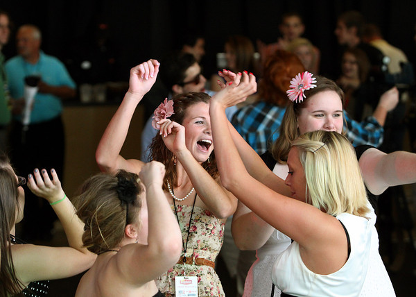 Henryville students dance during their prom event Wednesday at the KFC YUM! Center. The students were given a private show by Lady Antebellum and then a benefit concert by the band. Staff photo by C.E. Branham