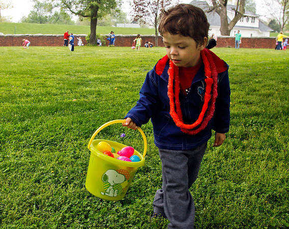 Nicolas Garay, 3, of Jeffersonville, searches for eggs on the west lawn during the five and under Easter egg hunt at the Howard Steamboat Museum in Jeffersonville on Saturday morning. Staff photo by Christopher Fryer