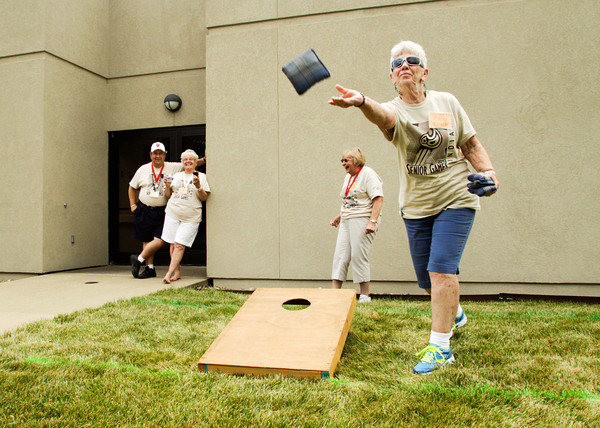 Patsy Leach, of Clarksville, tosses a bag while playing a round of toss 'em with her teammate Carolyn Lindsey, of New Albany, center right, at Southern Indiana Rehab Hospital in New Albany on Tuesday afternoon. The toss 'em tournament was the largest competitive event in the 27th annual Senior Games with 190 participants. The games will continue through Friday when the closing ceremonies will be held at Sacred Heart Catholic Church in Jeffersonville. Staff photo by Christopher Fryer