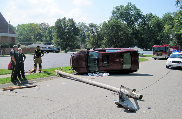 A motorist avoided serious injury Wednesday, though her car struck a light pole and ended up coming to rest on its side on Scheller Lane near Our Lady of Perpetual Health Catholic School in New Albany. <br /> The wreck occurred about 11:50 a.m., as officials said she lost control of her Ford Fusion while looking down at a GPS system for directions, as she was attempting to locate an address in the neighborhood. <br /> The light pole fell to the ground, but the driver was treated at the scene and officials said didn't appear to have any serious injuries. New Albany first responders, the New Albany Fire Department and the New Albany Police Department responded to the accident. <br /> — Staff photo by Daniel Suddeath