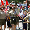 Members of Highland Cub Scout Pack 4043 march down Spring St. in the ninth-annual Celebrating Freedom Parade in Jeffersonville. Staff photo by C.E. Branham