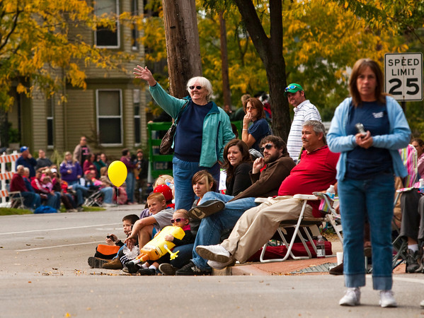 Parade goers look on as the Harvest Homecoming Parade moves down Spring Street in New Albany on Saturday afternoon. Staff photo by Christopher Fryer