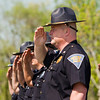 Indiana State Trooper 1st Sgt. Jamey Noel and his fellow officers salute while in formation in front of Post No. 45 in Sellersburg while taps is played during the annual Indiana State Police Sellersburg District memorial service for the 46 personnel members that have died while serving Indiana since 1933. Staff photo by Christopher Fryer