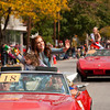 Emmy Scott, 4, of Floyds Knobs, and Miss Harvest Homecoming, Rebecca Davis, of Georgetown, wave to the crowd as they ride down Spring Street during the Harvest Homecoming Parade on Saturday afternoon in New Albany. Staff photo by Christopher Fryer