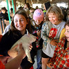 Brianna Reiter holds on to a squealing piglet as her classmates watch Tuesday morning during Ag Day at the Clark County 4-H Fairgrounds. More than 2,000 elementary school students from Clark County attend the annual event to learn about agriculture in their county. Staff photo by C.E. Branham