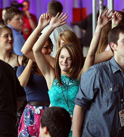 Henryville students get a dance line going during their prom event Wednesday at the KFC YUM! Center. The students were given a private show by Lady Antebellum and then a benefit concert by the band. Staff photo by C.E. Branham