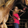"""Kelly Bratcher, of Floyds Knobs, listens to horse trainer Martin Schwartz, of Salem, as he works with her uncle's quarter horse """"Trigger"""" during an individual natural horsemanship session in the covered arena at Sunny Acres Stables in Greenville on Saturday afternoon. Staff photo by Christopher Fryer"""