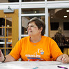 Floyd County event chairwoman for Relay For Life Jan McCauley, of New Albany, collects fees from teams and signs them up for their camp sites at New Albany High School on Tuesday evening. The event will take place on the track at New Albany High School and last from 7 p.m. Friday until 10:30 a.m. Saturday. Staff photo by Christopher Fryer