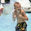 Charley Hammons beat the heat Thursday under a fountain at the Jeffersonville Aquatic Center. Staff photo by C.E. Branham