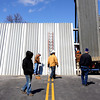 The Jeffersonville Street Department practiced installing the floodwall gate at the foot of Spring St. Wednesday. Staff photo by C.E. Branham