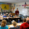 Gary Norrington goes over a math lesson with his fifth grade class on Feb. 20 at Henryville Elementary School. Norrington's classroom wasn't hit hard by the tornado nearly a year ago, but some of his belongings in the classroom are still lost in the shuffle after the renovation company, Belfor, stored away items from classes. Staff photo by Jerod Clapp