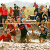 Racers negotiate the first series of obstacles during the Muddy Fanatic 5K Adventure Race at the former Glenwood Training Center in Sellersburg on Saturday morning. Over 2000 participants negotiated over 30 obstacles on a 3.1 mile course either as individual racers or as part of a team. Staff photo by Christopher Fryer