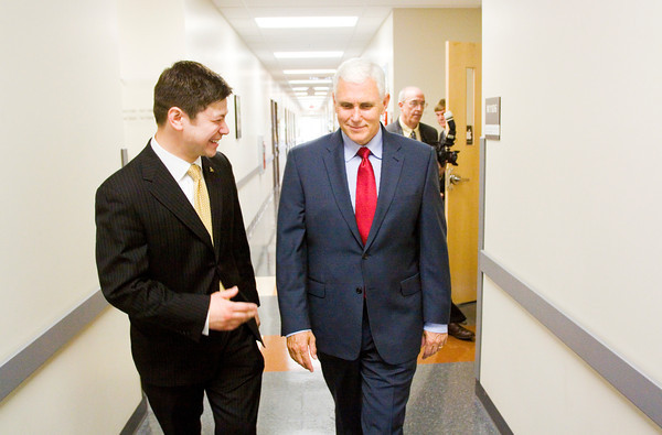 Indiana Gov. Mike Pence walks with Purdue University College of Technology at New Albany Director Andrew Takami following a tour of the school on Friday afternoon. Staff photo by Christopher Fryer