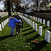 Mary Owen hugs her grandson, Jordan Tolson, 10, after placing a wreath on the grave of her husband, Billy Dewayne Owen, a Vietnam veteran, at the New Albany National Cemetery on Friday afternoon. The Hazelwood Middle School fifth-grade class participated in a wreath laying ceremony at the cemetery to honor veterans for the holiday season as part of Wreaths Across America. Students like Tolson with family members buried in the cemetery were given the opportunity to place wreaths on their graves. Staff photo by Christopher Fryer