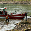 Officials from the Jefferson County, Ky Coroner's Office, the New Albany Fire Department and the New Albany Police Department search the Ohio River near the Sherman Minton Bridge with the help of a cadaver dog on Wednesday afternoon. Staff photo by Christopher Fryer