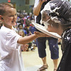 Bridgepoint Elementary School first-grader Jayden Strickland enjoyed putting a pie in the face of teacher Erica Hinton Friday at the Jeffersonville School.  More than a dozen teachers took a pie to the face to reward the students for raising $3,160.03 through the Pennies for Patients program. The proceeds benefit the Leukemia and Lymphoma Society. Staff photo by C.E. Branham