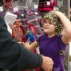 Hannah Campbell picks a new winter hat during the Shop with a Hero program Tuesday at the New Albany Meijer. Staff photo by C.E. Branham