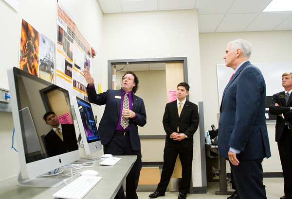 Indiana Gov. Mike Pence, right, looks on as Purdue University College of Technology at New Albany Associate Professor John Finnegan explains one of his class projects in the sketching, raster and vector imaging lab during the governor's tour of the school on Friday afternoon. Staff photo by Christopher Fryer