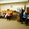 Judge Dan Moore speaks in honor of Margaret Read's years of service in the Clark County justice system and community in Circuit Courtroom No. 1 during Margaret Read Day at the Clark County Government Building in Jeffersonville on Thursday morning. Read worked as a court reporter in the original Circuit Court from 1953 to 1974 and continued to serve the justice system after that through her private deposition service. A portrait of Read was also unveiled in the courtroom during the ceremony. Staff photo by Christopher Fryer