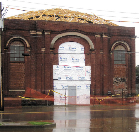 Crews have been installing a new roof for the Baptist Tabernacle building, located at 318 E. Fourth St. in downtown New Albany. The building has been without a roof since heavy winds damaged the structure in 2008. Staff photo by Daniel Suddeath.