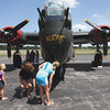 A spectator looks into the nose of a Consolidated B-24 Liberator Monday afternoon at Clark Regional Airport. The B-24 along with a Boeing B-17 Flying Fortress, and North American P-51 Mustang will be on display through Wednesday. Staff photo by C.E. Branham