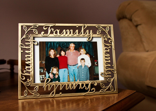 Janice and Frank Renn, center, are seen in a family portrait from Christmas of 1999 with their daughters Kimberly Camm, left, Debbie Karem, right, and their grandchildren Jill and Bradley Camm. Staff photo by Christopher Fryer