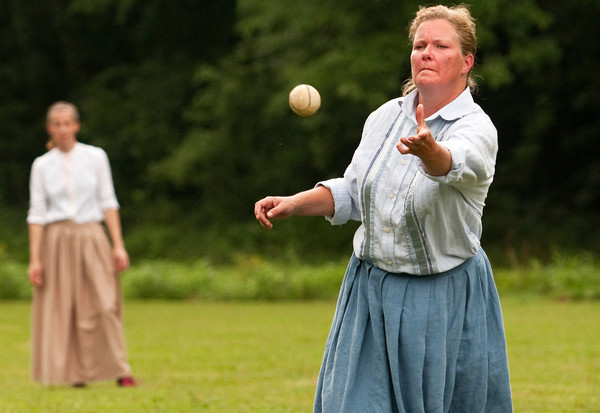 New Albany Petunias hurler and co-captain Betsy Starkey, New Albany, pitches during their old fashioned baseball game against the Lady Diamonds, out of Columbus, Ohio, at Binford Park in New Albany on Saturday. Staff photo by Christopher Fryer