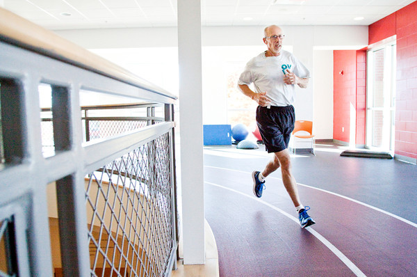 Gary Edelen, Floyds Knobs, runs laps on the indoor track at the Floyd County branch of the YMCA of Southern Indiana in New Albany on Wednesday afternoon. Friday marks the five-year anniversary of the facility that opened on November 15, 2008. Staff photo by Christopher Fryer
